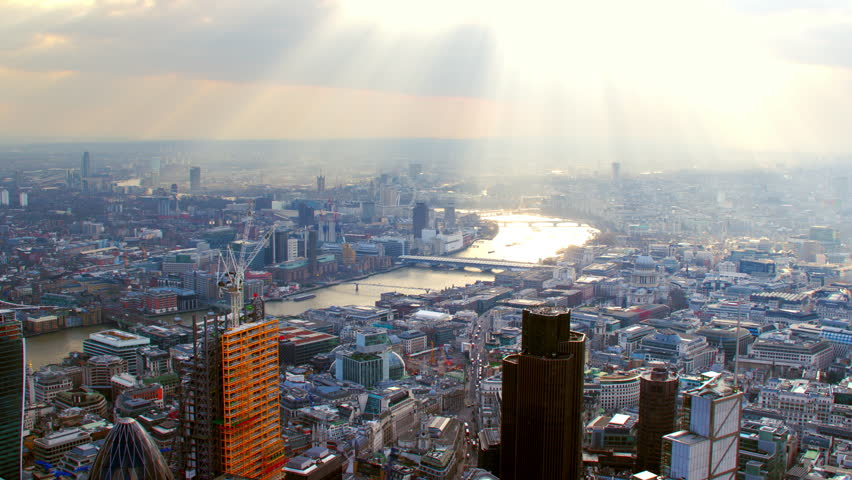 4K Aerial shot of Central London with view of the River Thames, St Paul's Cathedral, The City Financial District, London Eye, Blackfriars, Tate Modern