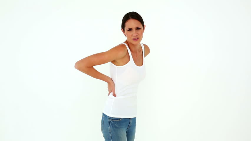 Slim model in jeans with a back ache on white background