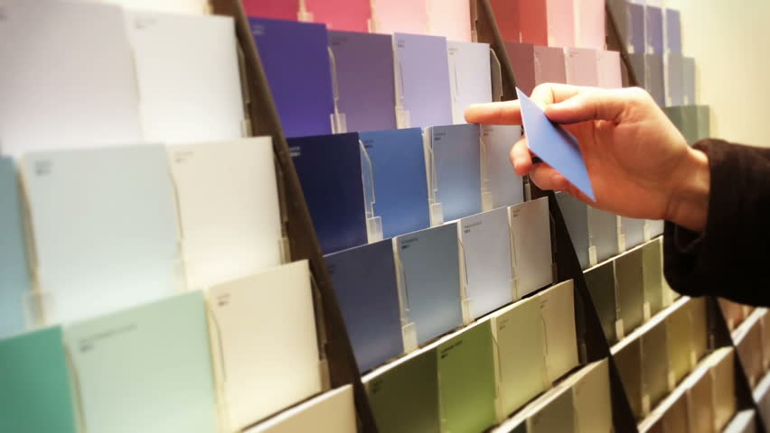 A man selects a paint sample.