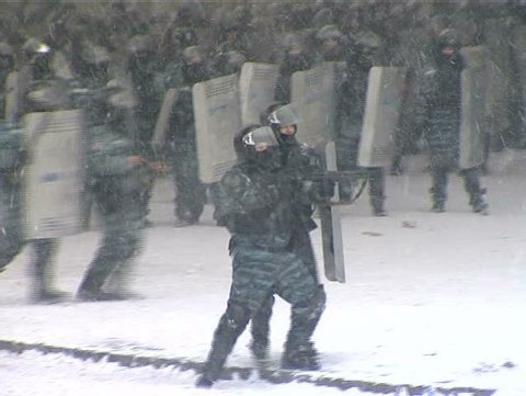 23. January. 2014. Ukrain.Kiev. Police disperse a crowd of rebels. Police shoot guns at people