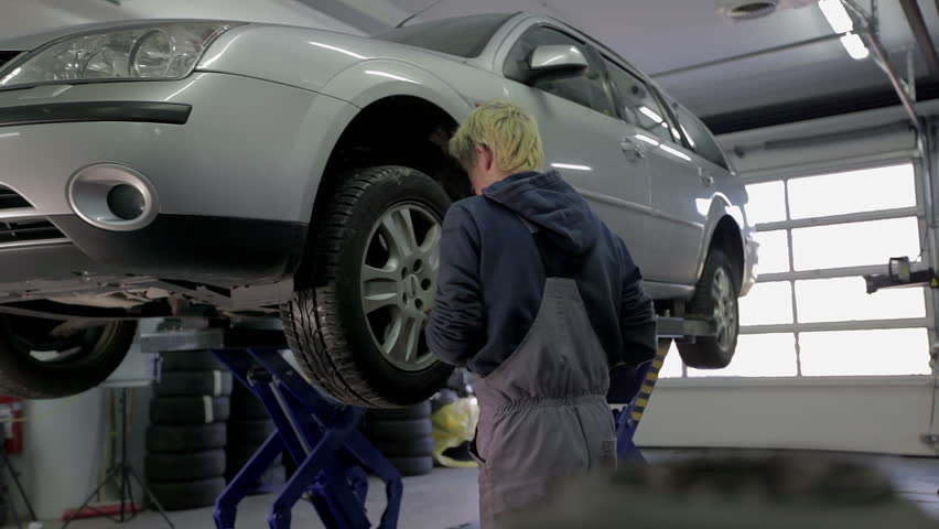 Vulcaniser Tightening The Tires On The Car Stock Footage Video