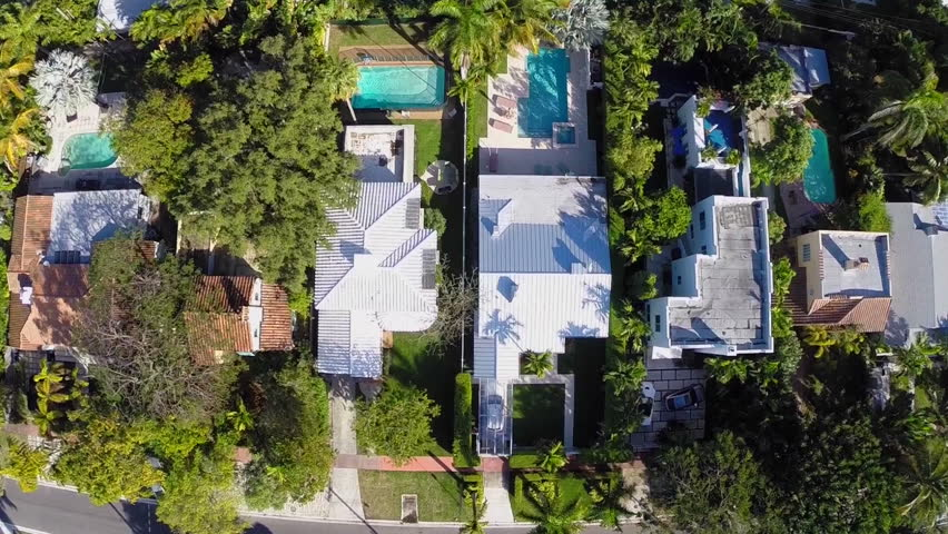 Aerial video of houses with swimming pools | Shutterstock HD Video #5571320