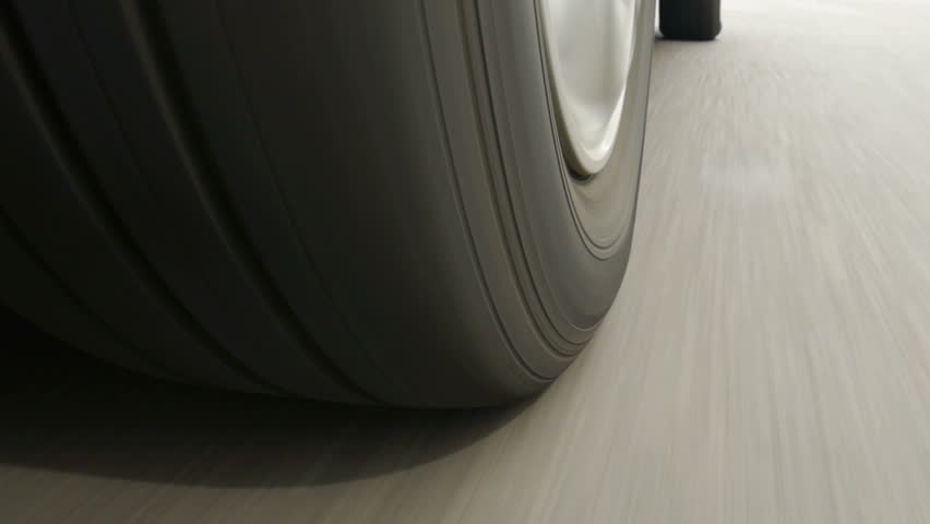 Car wheel spinning, Close UP / Detail Shot / POV - Point of View, day. Fast speed.