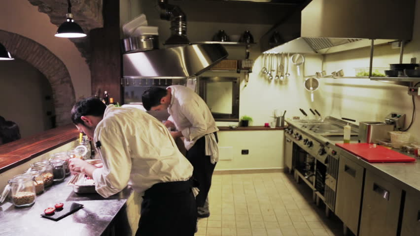 Restaurant Kitchen Video male chefs in hotel or restaurant kitchen working and washing