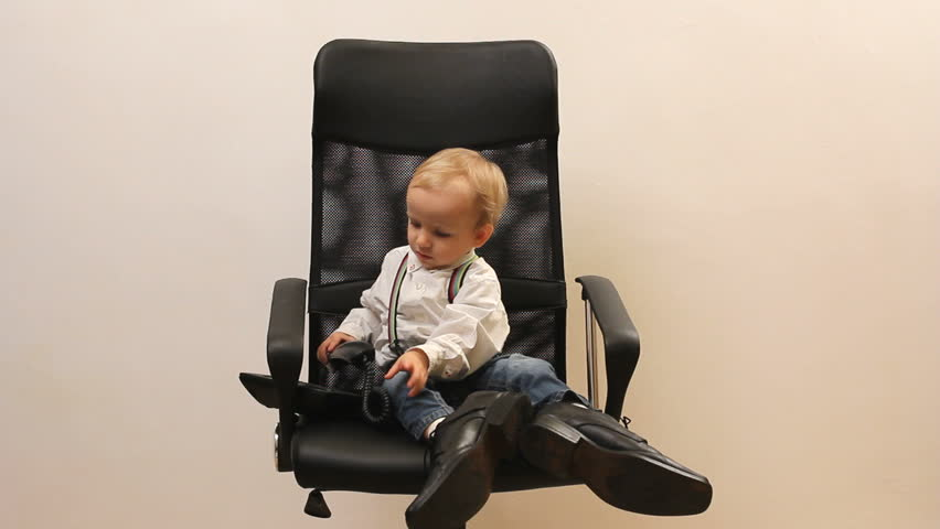 Little Child With Mobile Phone On Office Chair Stock Footage Video
