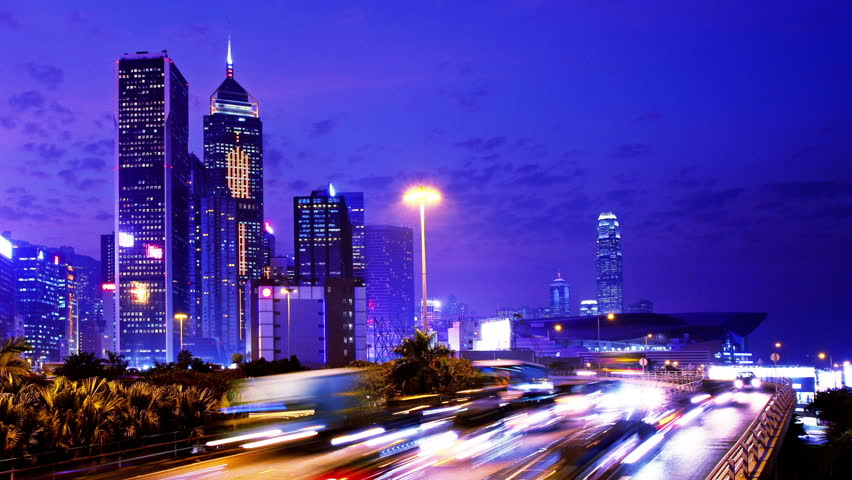 Busy Traffic At Night. Tight Shot. Hong Kong City Timelapse. Office  Buildings With