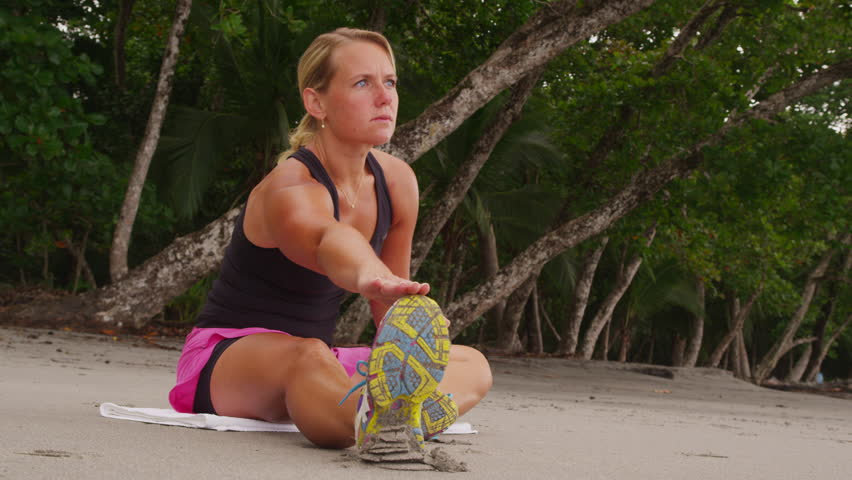 Woman stretching and preparing for run. Shot on RED EPIC for high quality 4K,