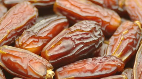 Date Fruits close up rotating smoothly. Progressive scan. Tripod used under studio lighting.