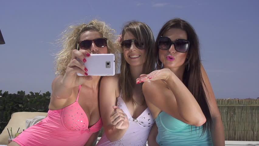 SLOW MOTION: Attractive women taking selfies