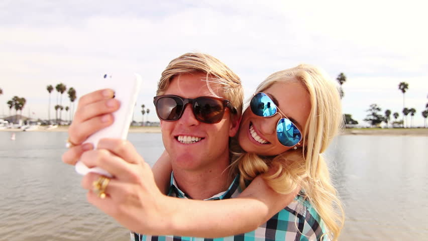 Young Happy Couple Taking Selfie (Self Portrait) Outside At Beach