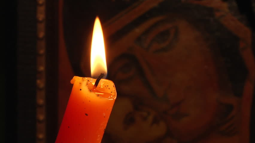 candle and Christian Orthodox icon
