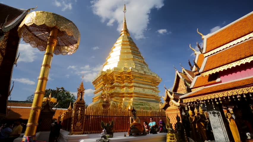 CHIANG MAI, THAILAND - CIRCA FEB 2014: Locals and tourists come to pray at the Doi Suthep Temple. The temple founded in 1385 is a major tourist attraction in Chiang Mai.