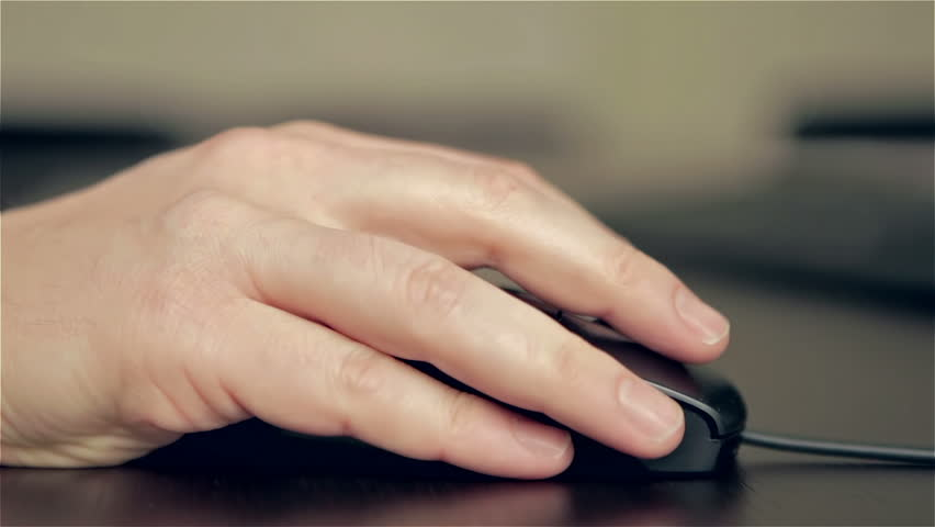 Man's hand using a wired computer mouse, clicking, scrolling and moving the device #5656823