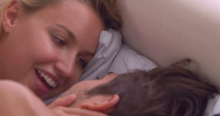 Intimate couple talking in bed at home in bedroom | Shutterstock HD Video #5661626