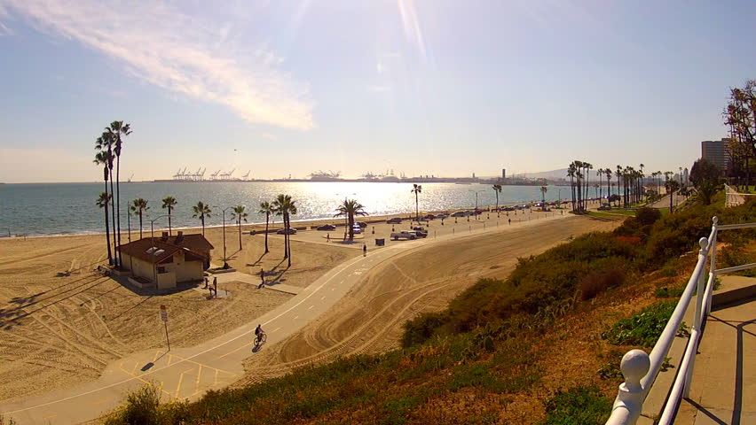 A wide angle view of the beach at Long Beach and Long Beach Bay in the afternoon sun of a winter day. .