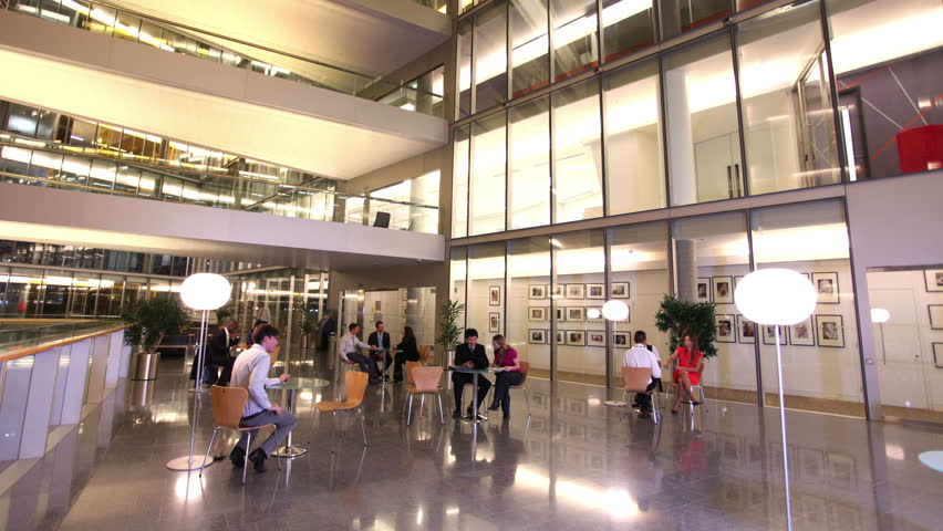 Time Lapse Of Diverse Group Business People In The Lobby A Modern Corporate Office Building At Night Stock Footage Video 5700236