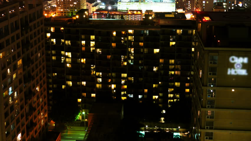 Apartment Building At Night time lapse of apartment building at night -zoom in- stock footage