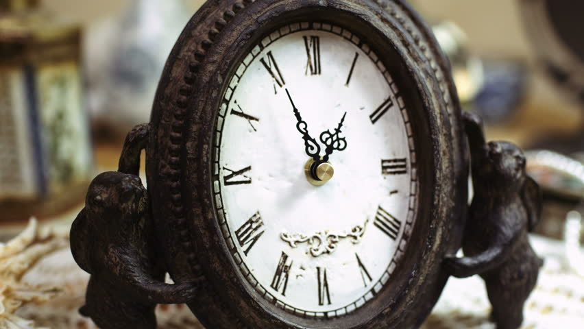 4K Time-lapse of beautiful, antique clock with decorations. Fine pattern of cracks formed on clock-face. Passing of time, (UHD, ultra high definition, 4096x2304, time lapse, timelapse) close-up shot