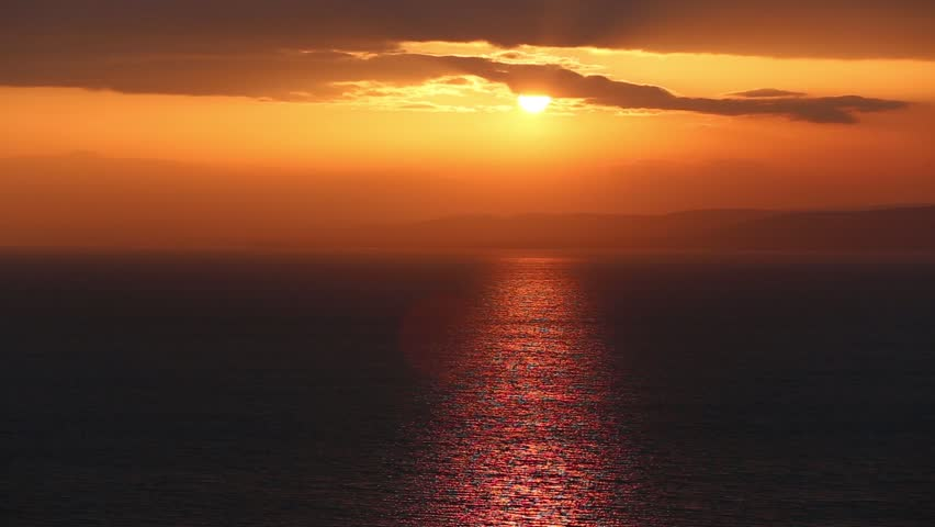 Beautiful sunset with sunrise over a water scape   Shutterstock HD Video #5789936