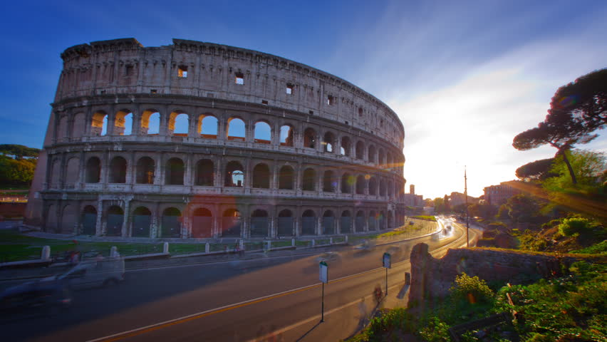 Time-lapse of the Colosseum and street traffic at sunset