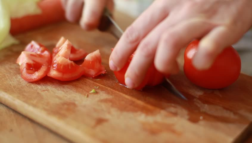 Woman hands slicing red tomato in kitchen (HD, high definition 1080p, 1920x1080, hidef) beautiful shot with soft focus. Healthy food concept. Dolly shot