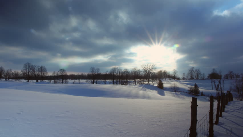 Snowy fields Timelapse. Timelapse of sun going down over snow covered fields. Ontario, Canada.