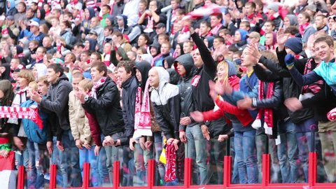MOSCOW, RUSSIA - SEP 9, 2012: Fans applaud at football match Spartak Moscow - Dynamo Kiev at Lokomotiv stadium.