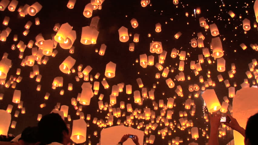 Hundreds of rice paper hot air balloons are launched during the Loi Krathong festival in Chiang Mai. | Shutterstock HD Video #5837366