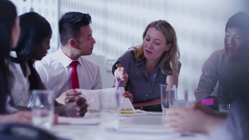 Cheerful mixed ethnicity business team brainstorming in a boardroom meeting. | Shutterstock HD Video #5843801