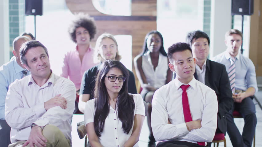 Cheerful Diverse Business Group Listening To The Speaker At A