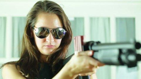 Woman assassin with a shotgun