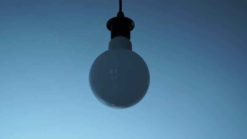 Design Round light bulb turns on and off in white grey environment.