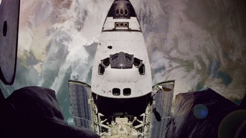 The space shuttle approaches a space station in orbit.  Aged video to simulate NASA archival footage.  Composited imagery courtesy of NASA.
