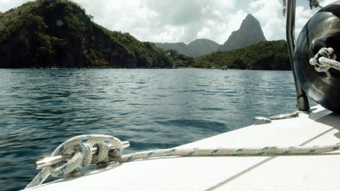 View from a yacht as it travels south on the west coast of St. Lucia with the iconic Piton mountains coming into view as the boat approaches Soufriere.