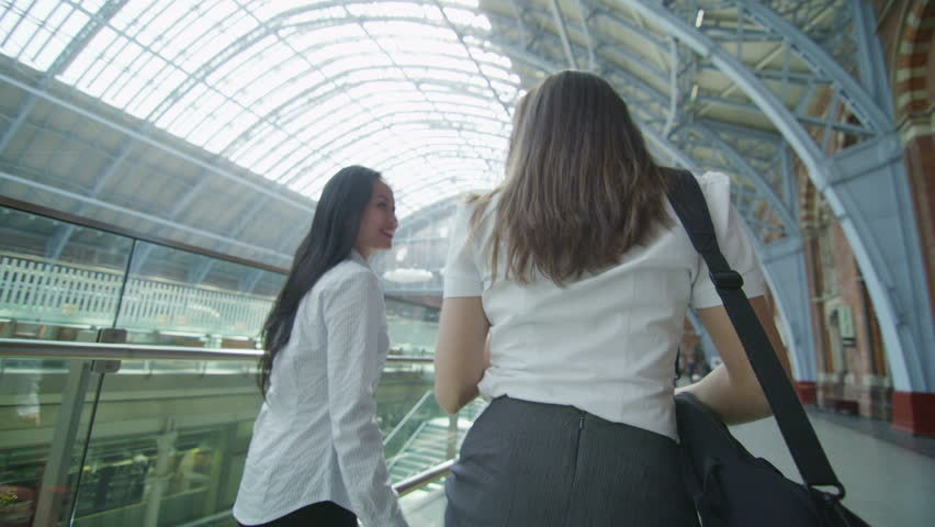 Attractive female friends walking through iconic London railway station   Shutterstock HD Video #5894726