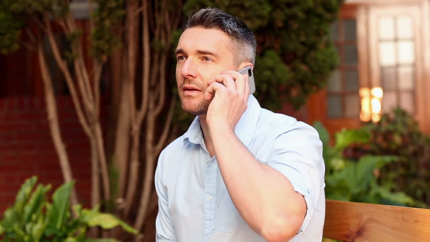 Happy lecturer talking on his phone on college campus | Shutterstock HD Video #5906897
