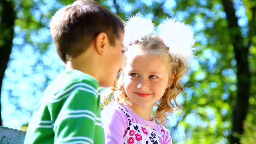 little boy is kissing pretty girl closeup portrait cute couple in love happy - Little Kids Pictures