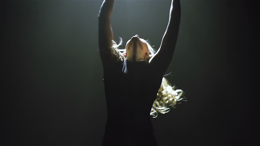 Young girl performing acrobatic dance