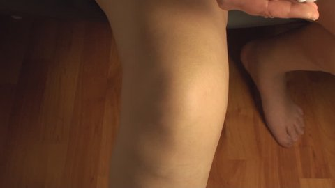 Woman Massaging Knee, Knee Injury, Pain, Treatment, Medical, Front-Shot