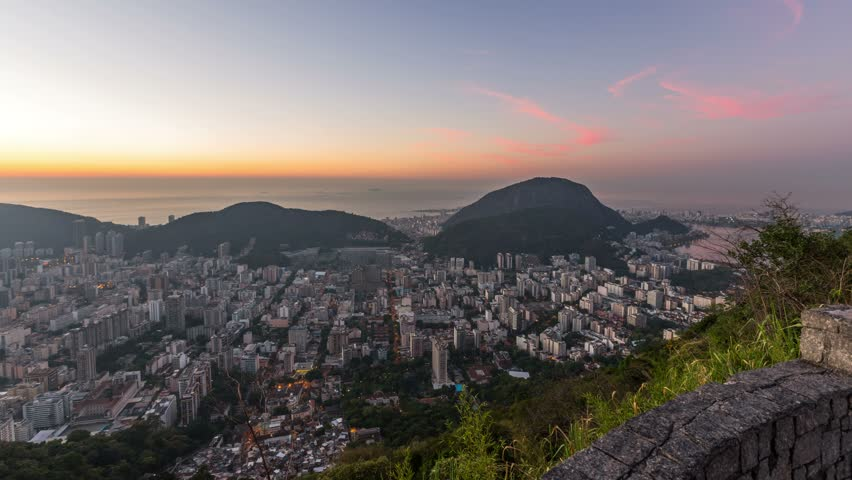 Rio De Janeiro panning cityscape time lapse of sunrise over Sugar Loaf Mountain. | Shutterstock HD Video #5963486