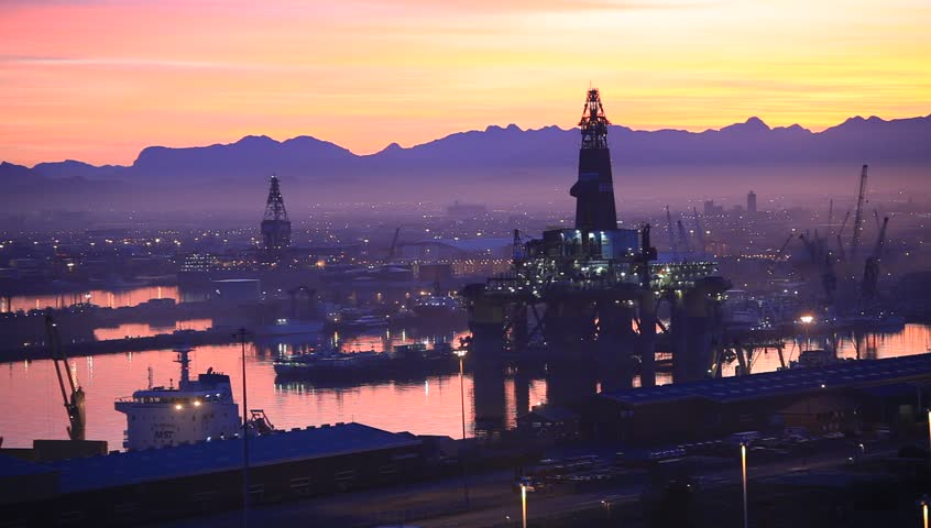 CAPE TOWN, SOUTH AFRICA - 15 OCTOBER : Semi Submersible Drilling Rig in Shipyard at Sunset Time on 15 October 2013. Shipyard Industry in South Africa for service offshore oil drilling rig