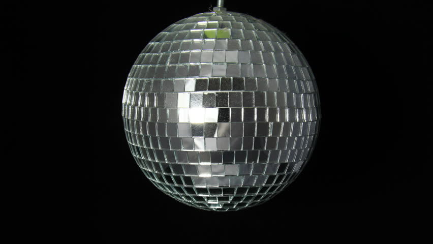 Mirror Ball 3 Dark. A mirror ball, also known as a disco ball, spinning against black. Minimal lights, no effects added. | Shutterstock HD Video #5978786