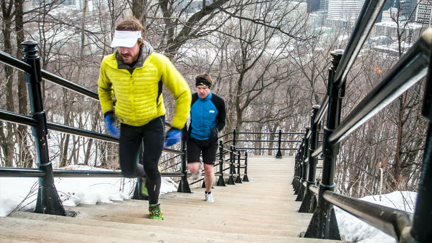 Male trail runners training on the Mount-Royal in the city of Montreal, Quebec, Canada.