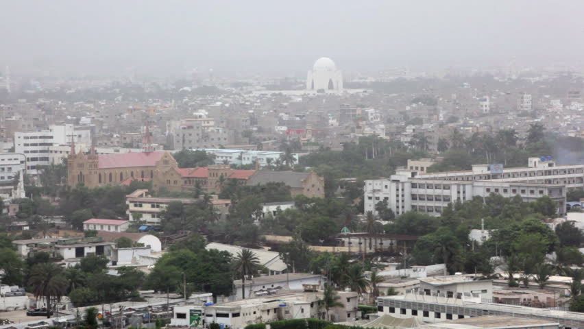 KARACHI, PAKISTAN: Rooftop aerial of inner-city Karachi with the Mazar-e-Quaid, or National Mausoleum on the horizon. | Shutterstock HD Video #6021236