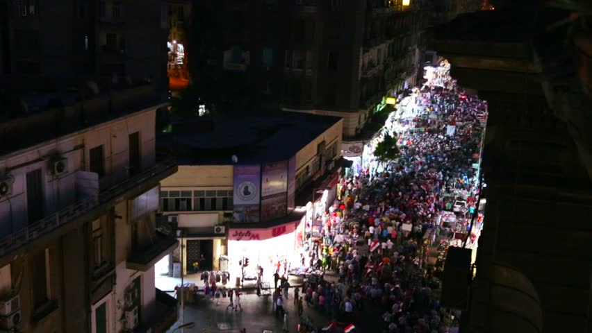 Overhead view of a large nighttime protest rally in the stets of Cairo, Egypt.