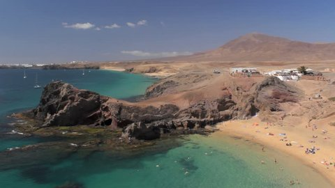 Turquoise waters and golden sand at Papagayo Beach, Lanzarote, Canary Islands, Spain