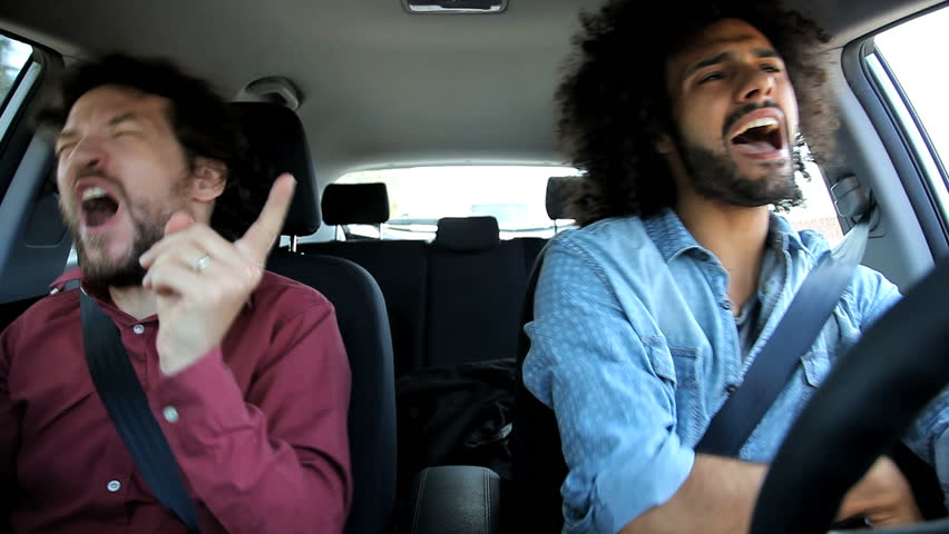 Two men in car having fun singing and dancing | Shutterstock HD Video #6089354