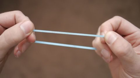 Pulling and breaking a rubber band