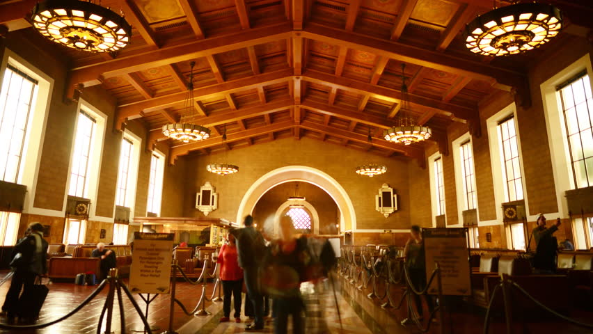 4K Time Lapse of Historic Union Station in Los Angeles with Commuters in Motion Blur  -Tilt Up-