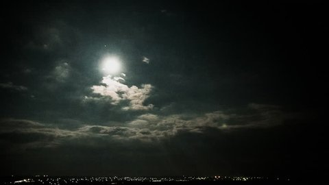 Moon in the sky with clouds. Time lapse. 4k